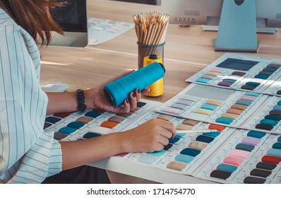 Fashion designer working desk with colorful sewing thread and fabric sample