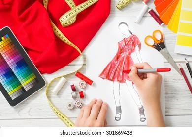 Fashion designer working in studio. Close up design.