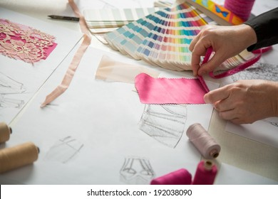 fashion designers, working in progress on tailor table
