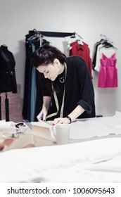 Fashion designers working in studio working at a tailor shop