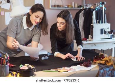 Fashion Designers Working In Their Art Studio
