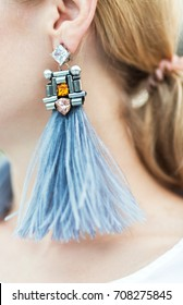 Fashion earring on the ear. Street Style look