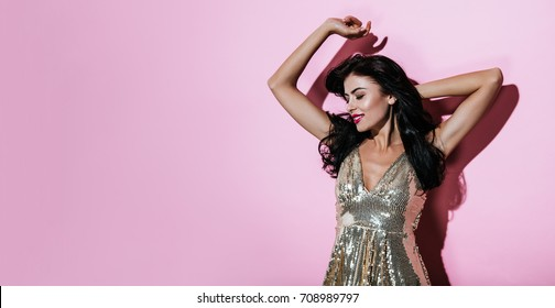 Fashion emotional Woman with Perfect Makeup. Disco style. Beautiful Professional Holiday Make up. Dressed well. Beauty Cheerful Girl  studio portrait .