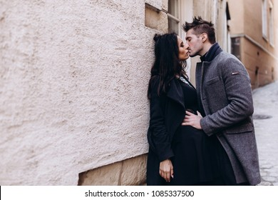 Fashion engagement shooting, photo session for beautiful couple, walk of a couple in love around the city and park.