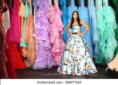 Fashion Evening Gown Long Ball Dress in Asian Female Model with Colorful Hanging layer pastel clothes closet wardrobe, studio lighting sequin floor