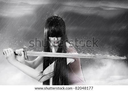 Fashion fantasy portrait of young pretty brunette woman fighter with sword in mist