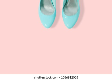 fashion female blue shoes. Women's fashion shoes casual design isolated on pink background. Front view close up.