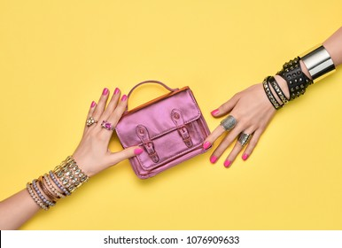 Fashion. Female hand, Stylish Jewelry Accessories. Minimal Design. Shopping Sales Discount concept. Summer Hipster Girl Essentials. Glamor Trendy Handbag Clutch. Creative Art.