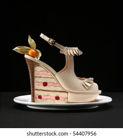 Fashion female shoes and cake