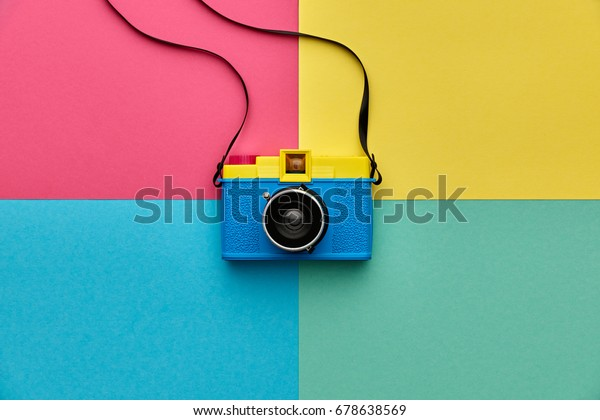 Fashion film camera. Minimal hipster summer trend flat lay. Retro design camera on vivid color. Summertime concept. Trendy fashionable film camera, creative pop art
