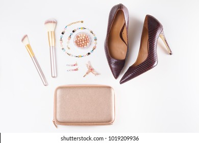 Fashion flat lay scene. Hight heel shoes, bag, dressing up for party fashion accessoires.