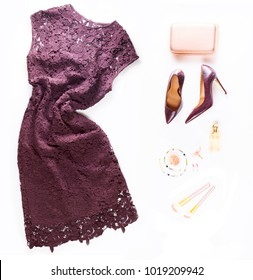 Fashion flat lay scene. Hight heel shoes, dress, bag, dressing up for party fashion accessoires.