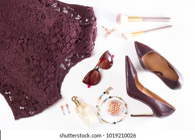 Fashion flat lay scene. Hight heel shoes, lacy dress, dressing up for party fashion accessoires.