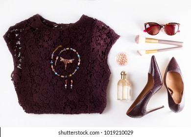 Fashion flat lay scene. Hight heel leather shoes, lacy dress, dressing up for party fashion accessoires.