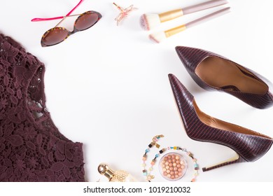 Fashion flat lay scene. Hight heel shoes, lacy dress, dressing up for party, frame of fashion accessoires.