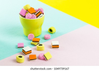 fashion food candy: liquorice allsorts in a yellow cup