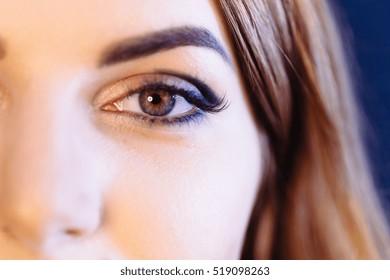 Fashion ginger woman eye makeup. Close-up macro. Beauty concept.