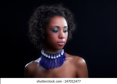 Fashion Girl. Beautiful Makeup and Healthy Hair. Beautiful smiling african american girl. Beauty Model Woman Face. Perfect Skin. Professional Make-up.Fashion Art.Vogue Style.