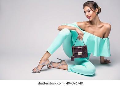 fashion girl holding red handbag