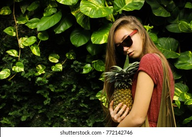 Fashion girl in nature background and take pineapple