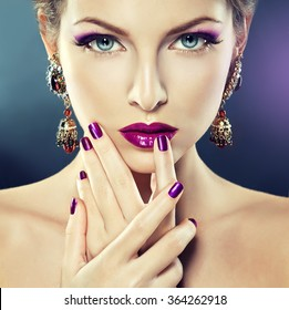 Fashion Girl Portrait . Beautiful girl model with purple makeup and manicure  on the nails .