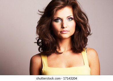 Fashion girl posing on light background - portrait