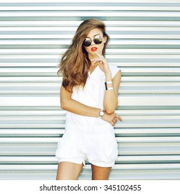 Fashion girl in sunglasses posing outdoor