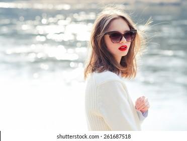 fashion girl in sunglasses. vacation at sea