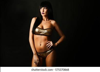 Fashion girl wearing swimming suit in studio