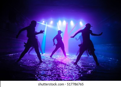 Fashion girls dancing on the water