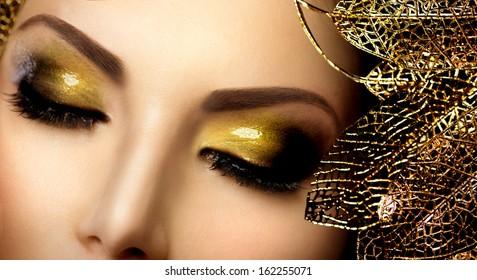 Fashion Glamour Makeup. Glamor Golden Make-up. Holiday Gold Glittering Eyeshadows