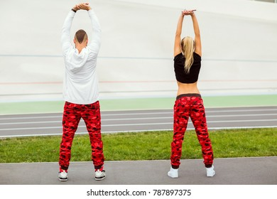 fashion guy with a girl posing in the same sportswear
