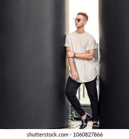 fashion guy posing in sunglasses on sunset