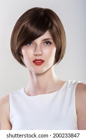 Fashion Hairstyle Glamour Young Woman Portrait. Blue eyes, Red Lips.