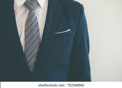 Fashion the hands of a young businessman  handsome model man on his business suit close up