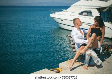 Fashion. Happy day. Sea background. Young couple in love outdoor.Stunning sensual outdoor portrait of young stylish fashion couple posing in summer. Lifestyle, dreaming, dream. Passion. Sexy girl. Sex