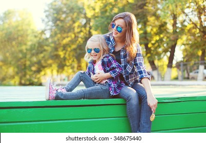 Fashion happy mother and child daughter having fun together in the city
