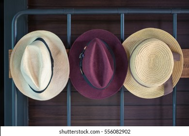 Fashion hats hanged on a steel hanger rack