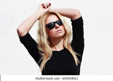 Fashion hipster girl in cool sunglasses.