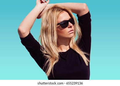 Fashion hipster girl in cool sunglasses