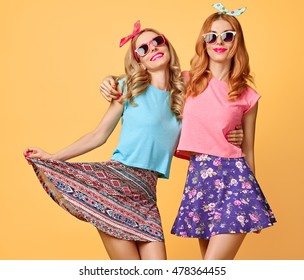 Fashion Hipster woman Having Fun Crazy Cheeky Dance. Hipster Sisters Best Friends Twins in Stylish Summer Outfit. Funny Model Girl in Sunglasses. Glamour  Trendy Hairstyle