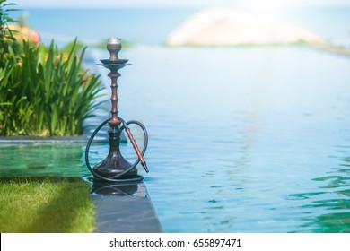 Fashion Hookah on the tropical beach pool.