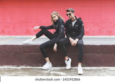 Fashion image of couple, standing on the street next to the coffee shop wall, skirt, long or short pants, jeans or khaki, shirts, stylish clothes, professional model, Vietnam, June 30 2019