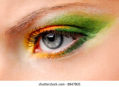 Fashion Image of woman eye with ceremonial bright make-up