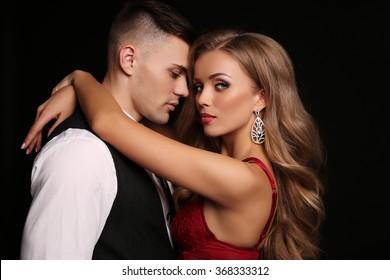 fashion interior photo of beautiful couple in elegant clothes