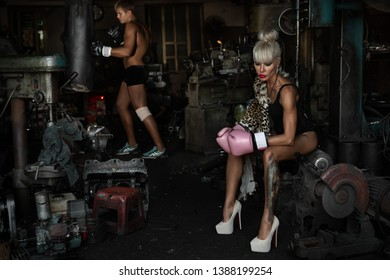 Fashion interior photo of beautiful sportive woman in a garage with her trener