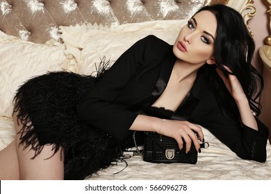 9217d71b0 fashion interior photo of gorgeous woman with dark hair and evening makeup,  in elegant clothes