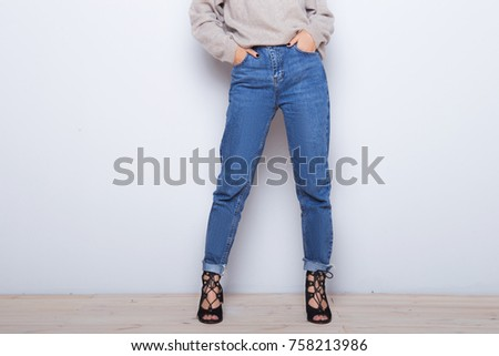 2b40f5929f Fashion jeans on a girl. Thin legs of fashion girl. Shapely female legs in