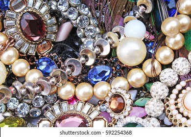 Fashion jewels as background. Jewelery texture. . Necklace earrings bracelet pearls gemstones as background.