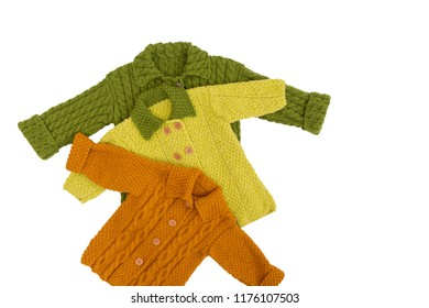 Fashion knitted handmade cardigans (jackets) for boy and girl isolated on white background/ Baby wear/ Knitting/ Hobby/ Top view/ Flat lay